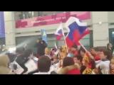 Национальным гимном, флагами и скандированием «Россия!» встретили нашу олимпийскую сборную по хоккею в Южной Корее