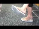 Candid Asian girl shoeplay white flip flop