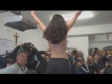 WATCH: Moment topless activist confronts Silvio Berlusconi as he casts vote