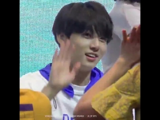 jungkook was teasing the fan and purposely missed her high five aw he's so cute look at hi
