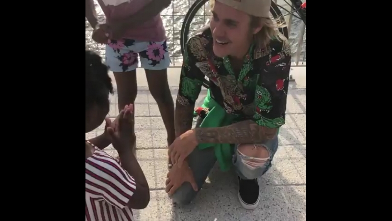 June 16: Fan taken video of Justin with fans spotted at the Domino Park in New York City.