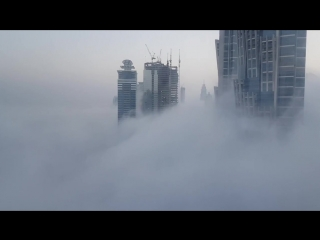 Dubai in the middle of fog and clouds