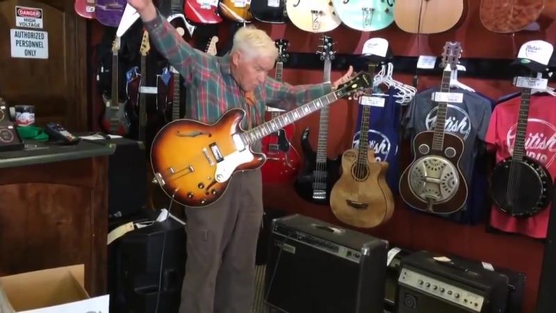 81 летний дедушка и гитара - в магазине. :))