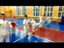 Малыши делают Тоби мае-гери (в кихон ката на 2 кю. Коричневый пояс) и подводящее упражнение в прыжковой технике ударов ногами