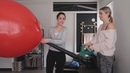Girls inflating large balloons with leaf blower popping and playing