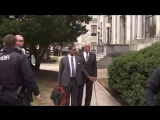 Bill Cosby confronted by topless protester