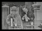 Bud Abbott shows Lou Costello a magic trick that he's working on