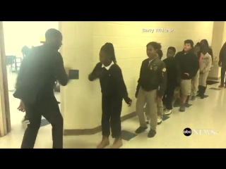 English teacher in NC has a personalized handshake with all his students