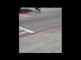 Amputee woman crutching on street