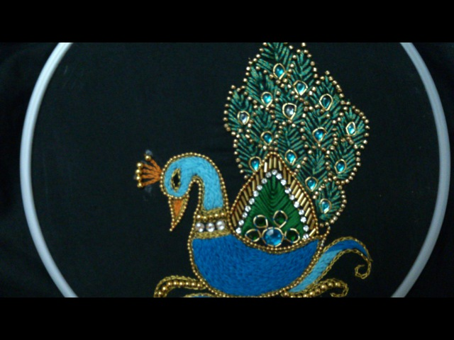 Hand embroidery designs. Aari style peacock embroidery for ghagras, dresses, sarees and blouses.