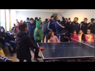 FC Banants footballers playing table tennis with