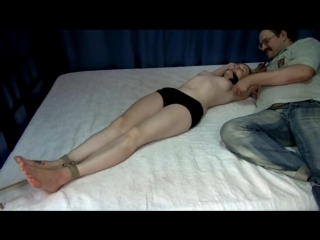 Tied to bed and tickled