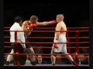 Journeyman tony booth getting booed. to shut the crowd up he does the ali shuffle and knocks out his opponent
