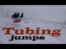 Тюбинг зимой прыжки и трюки с трамплина на ледянках, экстремальное катание с высокой горы