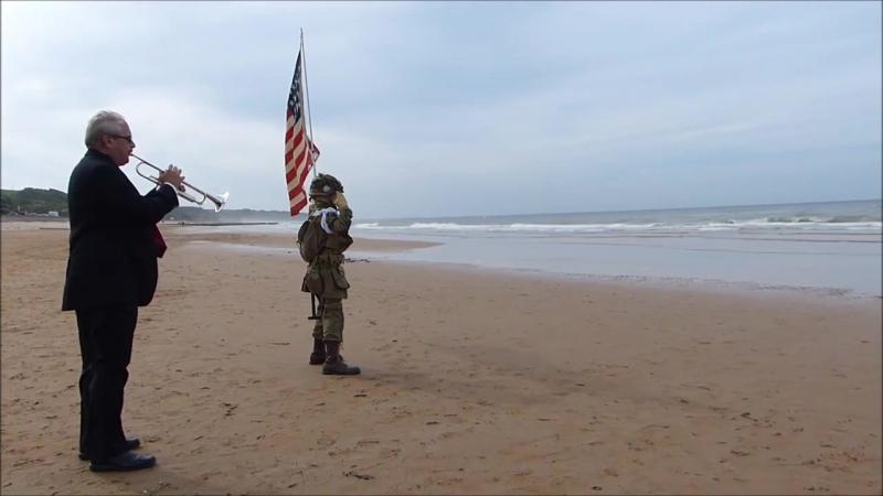 11 year old boy saluting fallen American heroes of D-Day. 11-летний мальчик приветствует погибших героев Америки во Франции.