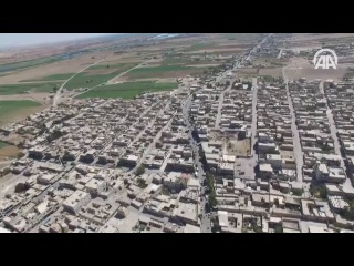 Видео приграничного с Турцией Сирийского города Джарабулус, снятое с турецкого беспилотника.