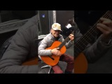 Old man playing western Ennio Morricone music on classic guitar