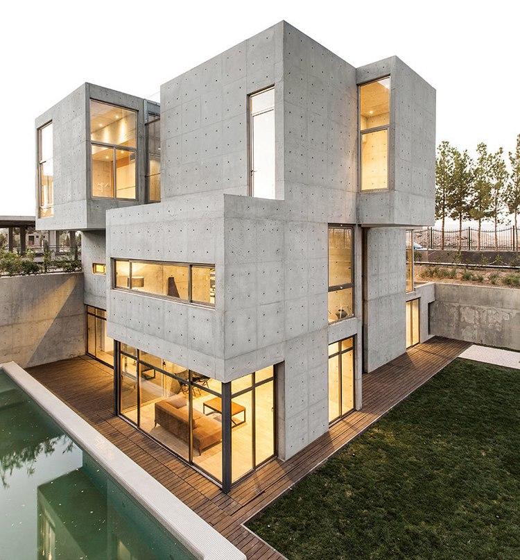 bracket design studio completes concrete villa 131