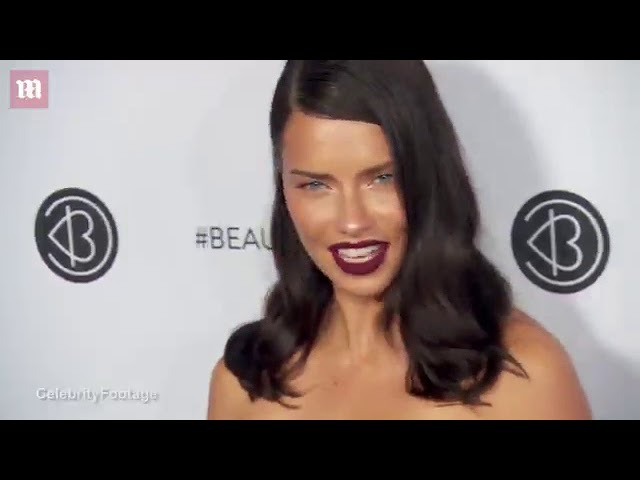 Lip service Adriana Lima wears dark plum lipstick at Beautycon