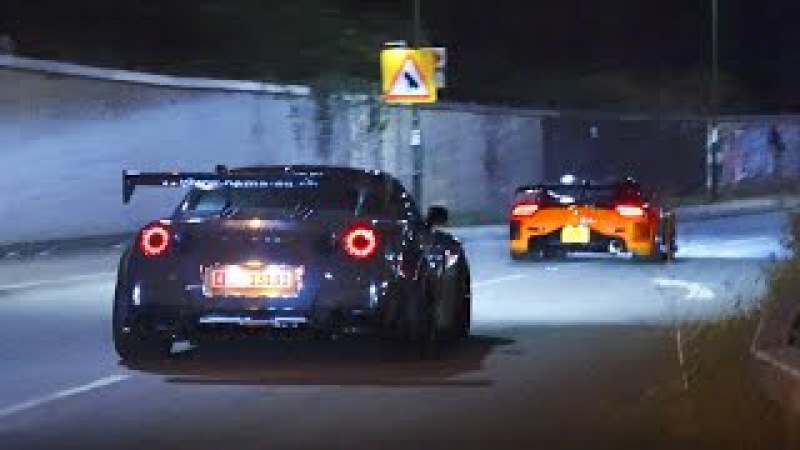 Veilside Mazda RX7 and Liberty Walk Nissan GT R on the street