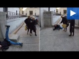 Uma Thurman helps a photographer up after he falls in front of her