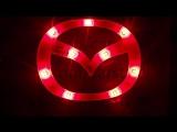 Эмблема с двухцветной светодиодной подсветкой Mazda красного и белого цвета