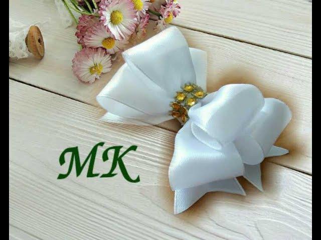 Делаем пышный бант из лент We make a lush bow of ribbons