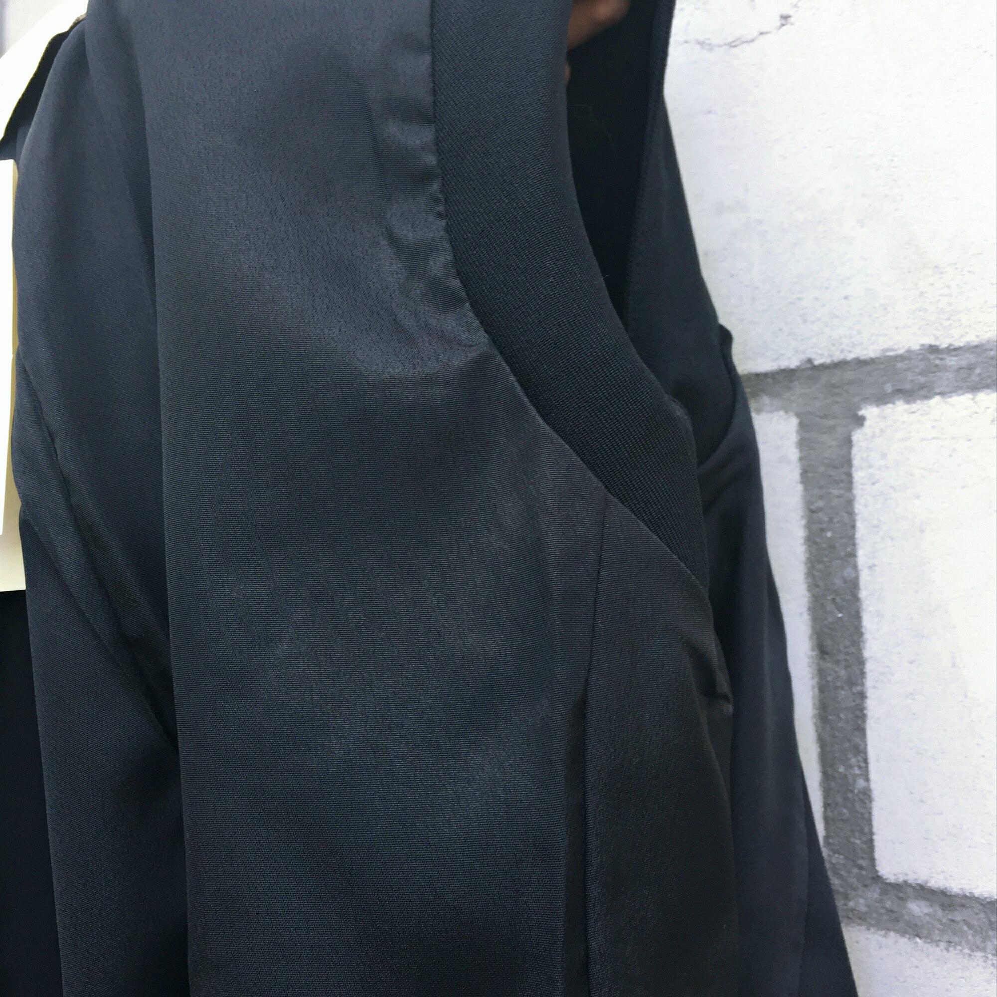Качественный черный жилет