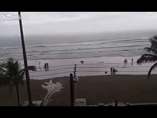 Exact Moment when Tourist is hit by lightning at a beach in Brazil