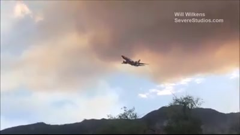 Flames burning near Lake Elsinore, CA. Uncontained wildfire has burned 200 acres and threatens almost 50 homes.