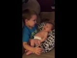 Older Brother Sings to Baby Sister