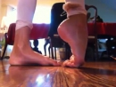 Young gymnastics girl with beautiful soft flexible feet.