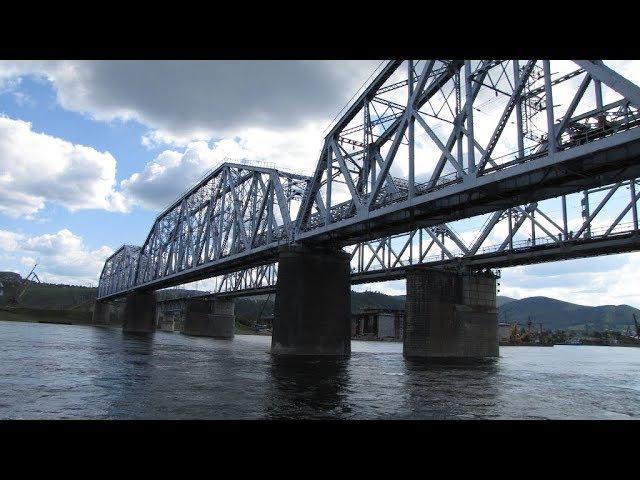 TRAIN ON THE BRIDGE OVER THE YENISEI RIVER