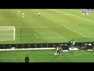 Security guard catching a  paper aeroplane during a brazil vs argentina friendly