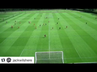 Jack Wilshere scores a spectacular lob over Petr Čech in Arsenal training.