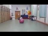 Girl does backflips with exercise ball