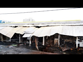 Последствия пожара на Привозе: мародеры и продавцы, спасающие товар