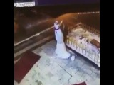 LiveLeak - She's trying to knock down the snowman