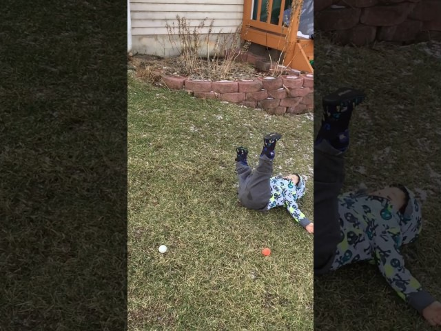Toddler fails at golf swing