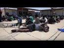 Ливия Мигранты задержаны в Триполи после того как береговая охрана перехватывает лодку направляющуюся в Италию