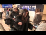 Lea Michele arrives at LAX full of chatter in her fur coat