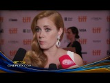 Amy Adams, Aaron Taylor Johnson and Tom Ford on the red carpet of Nocturnal Animals