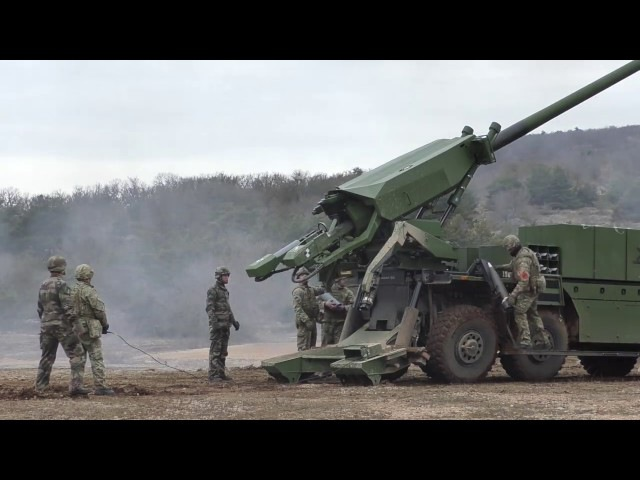Danish troops firing CAESAR 8x8 self-propelled artillery system