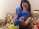 Blowing & nail pops heart balloons