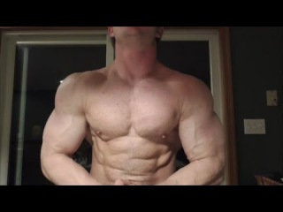 Lumberjack Muscle Man Chopping Wood and Flexing Huge Lean Muscles