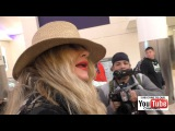 Jennifer Coolidge talks about the Obamas leaving office while departing at LAX Airport in Los Angel