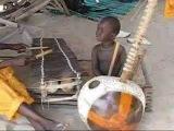 2 year old Gambian jali plays kora & balafon