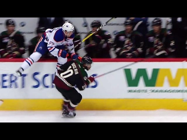 McDavid soars into Coyotes bench avoiding Duclair hit