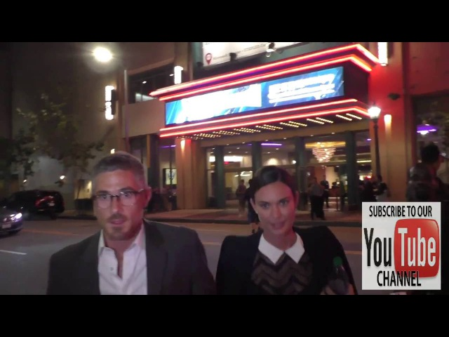 Dave Annable and Odette Annable on Pokemon Go while leaving Regal LA Live Theatre in Los Angeles
