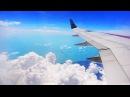 Полет над морем. Вид с самолета. Небо. Красивые облака, закат.